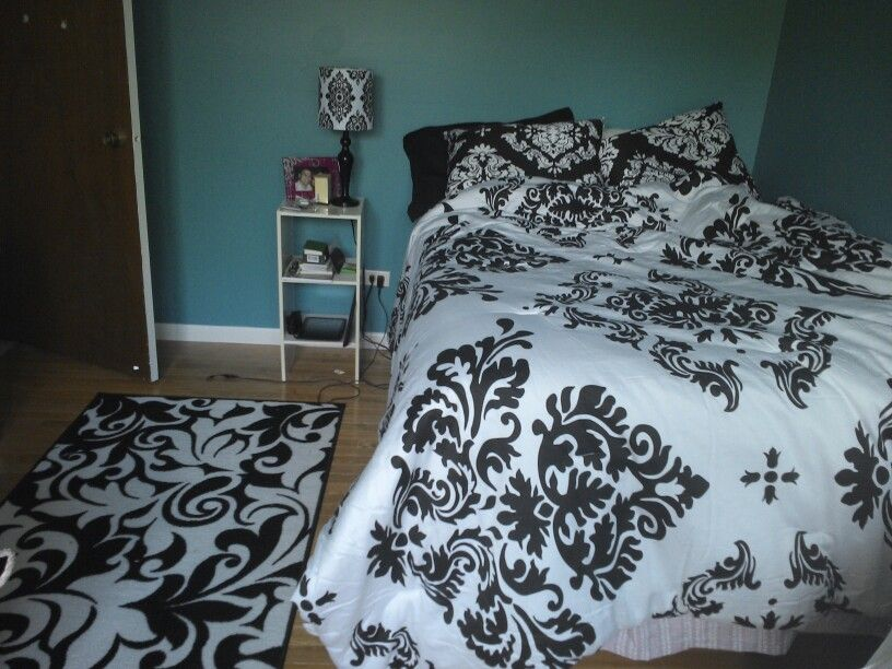 Black And White Damask With Teal Bedspread And Rug Are