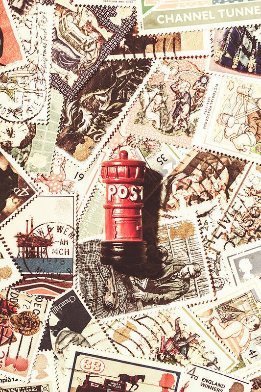 Traditional British still life artwork on a iconic Great Britain post box on a abstract scattering of stamps from England by Jorgo Photography - Wall Art Gallery