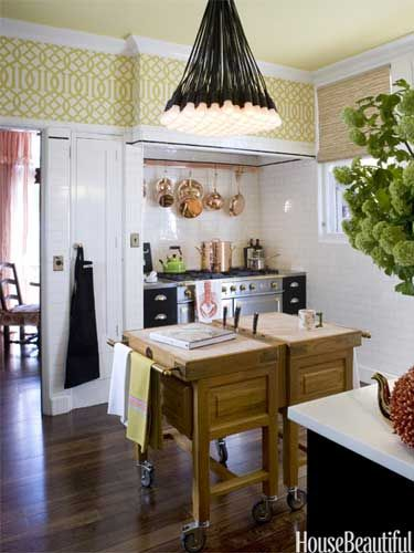 """Don't: Think bigger is always better. """"A well-designed kitchen with high-quality materials and thoughtful details can make even the smallest space suit you perfectly,"""" designer Tish Key says. In this compact California kitchen, an island on castors can be easily be moved around to where it's needed most. Rusty Reniers  - HouseBeautiful.com"""