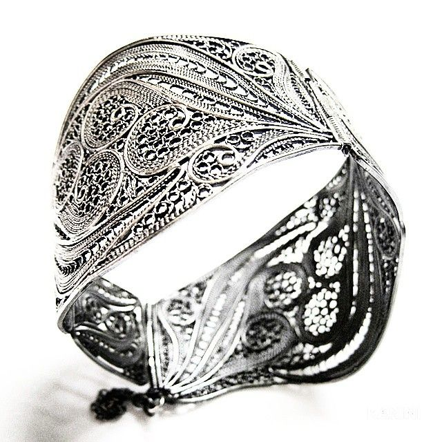 Traditional-style handmade filigree bangle made from silver.  Feel free to email us with any requests at kanini.jewelry@gmail.com.  We look forward to hearing from you!