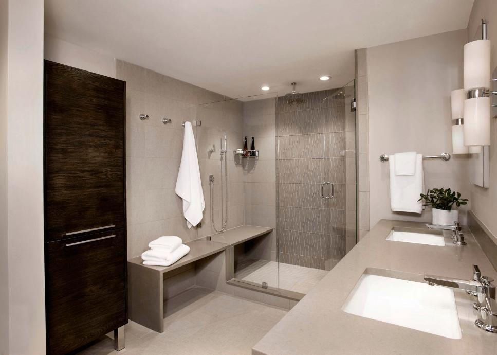Neutral Contemporary Bathroom With Oak Storage Cabinet White Bathroom Decor Bathroom Remodeling Trends Bathroom Design Trends