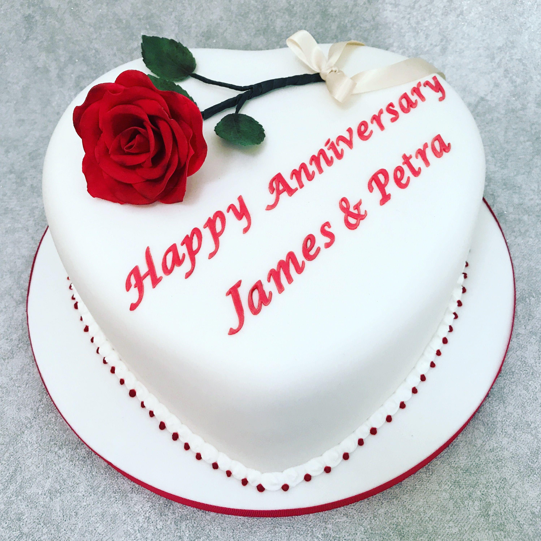 Heart shaped wedding anniversary cake with handmade sugar