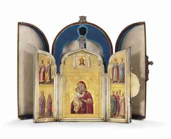 A LARGE PARCEL-GILT SILVER TRIPTYCH - MARKED SAZIKOV WITH THE IMPERIAL WARRANT, ST PETERSBURG, CIRCA 1850-1860s - Traditionally shaped, the hinged covers opening to reveal the Feodorovskaya Icon of the Mother of God flanked by ten saints, all within silver-gilt stepped rims, the exterior of the hinged sides decorated with silver-gilt scrolling foliage & cast & chased cartouche depicting Archangel Michael...9 7/8 in. (25 cm.) high