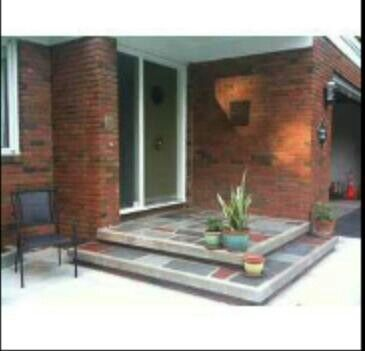 Tiled concrete patio with steps in a modern craftsman style