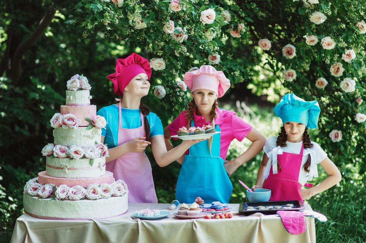3 Persons Preparing The Cake And The Cup Cakes Free Stock Photo