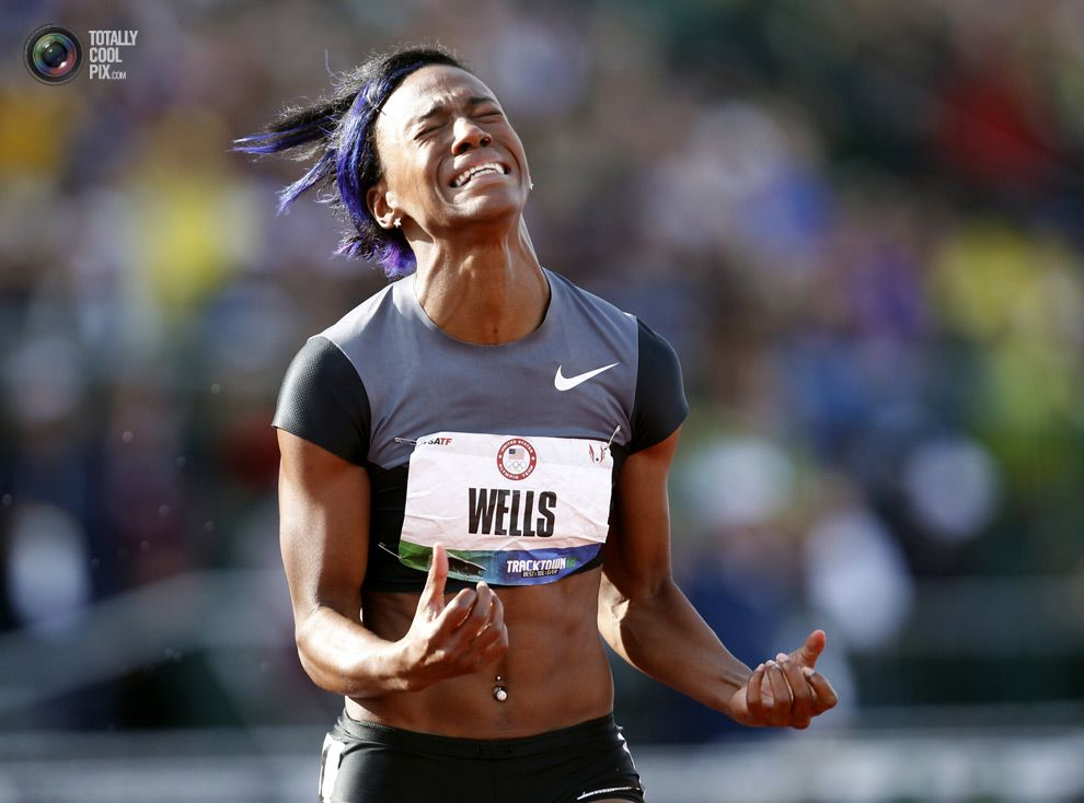 U.S. hurdler Kellie Wells reacts after placing second in the women's 100 meter hurdles during the U.S. Olympic Athletic Trials in Eugene. ROBERT GALBRAITH/REUTERS