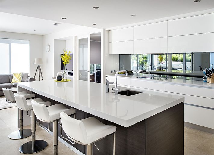 Make Your Kitchen Seem Larger And Brighter By Using A Mirror Backsplash In Your Kitchen