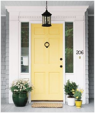 Great front door color, goes great with the grey shingles and white trim- Benjamin Moore hawthorne yellow HC-4
