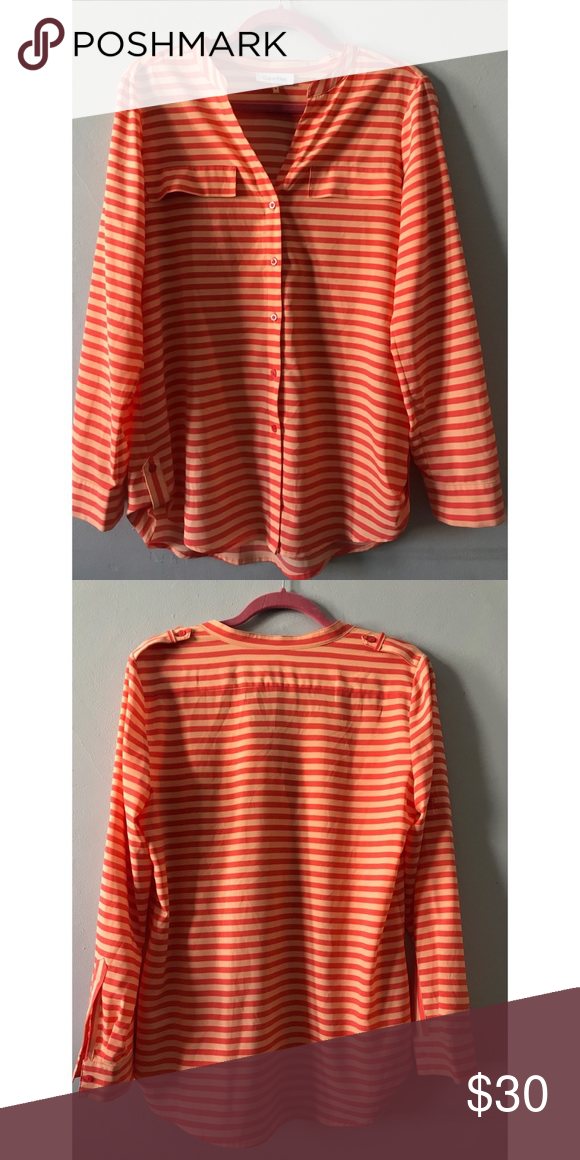 c63a5b4e3e2 Calvin Klein | Striped Button Down Blouse This Calvin Klein blouse features  a Y neckline,