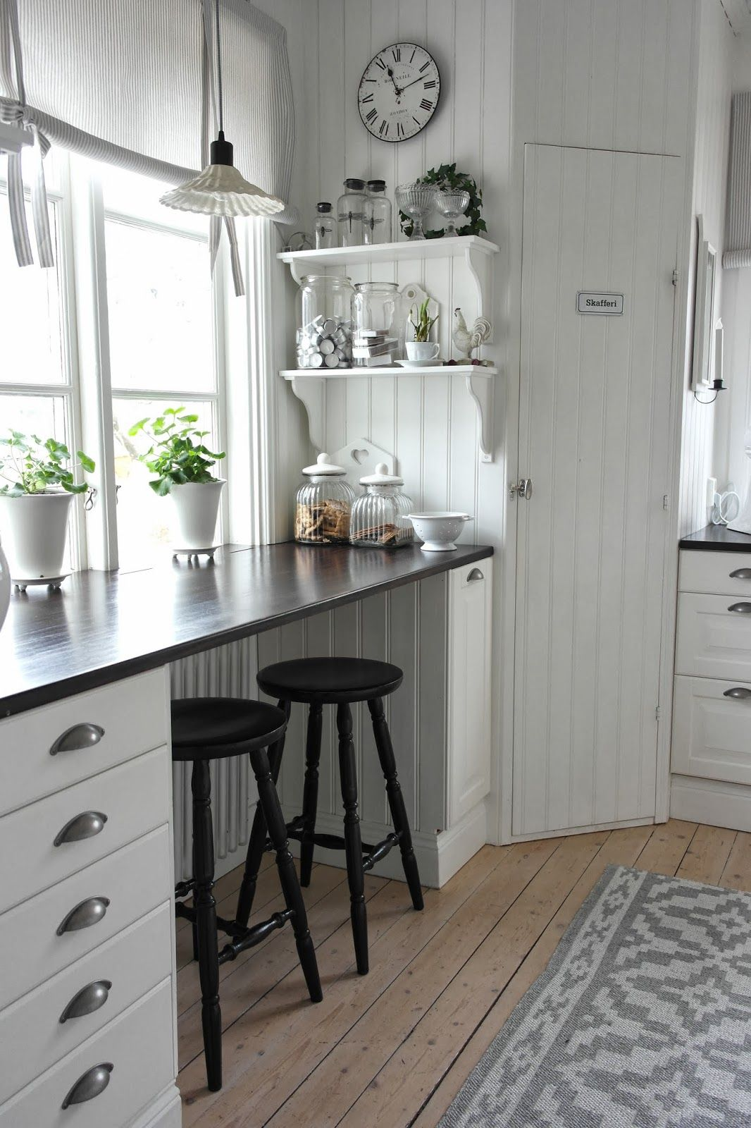 3 panel kitchen window  open shelving next to the stove for most used spices hang spoons