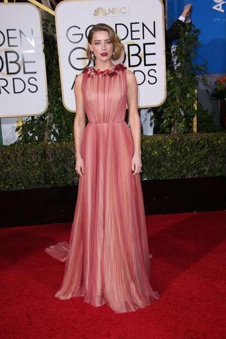 Amber Heard attends the 73rd Annual Golden Globe Awards in Los Angeles on Jan. 10, 2016. - REX/Shutterstock/Rex USA