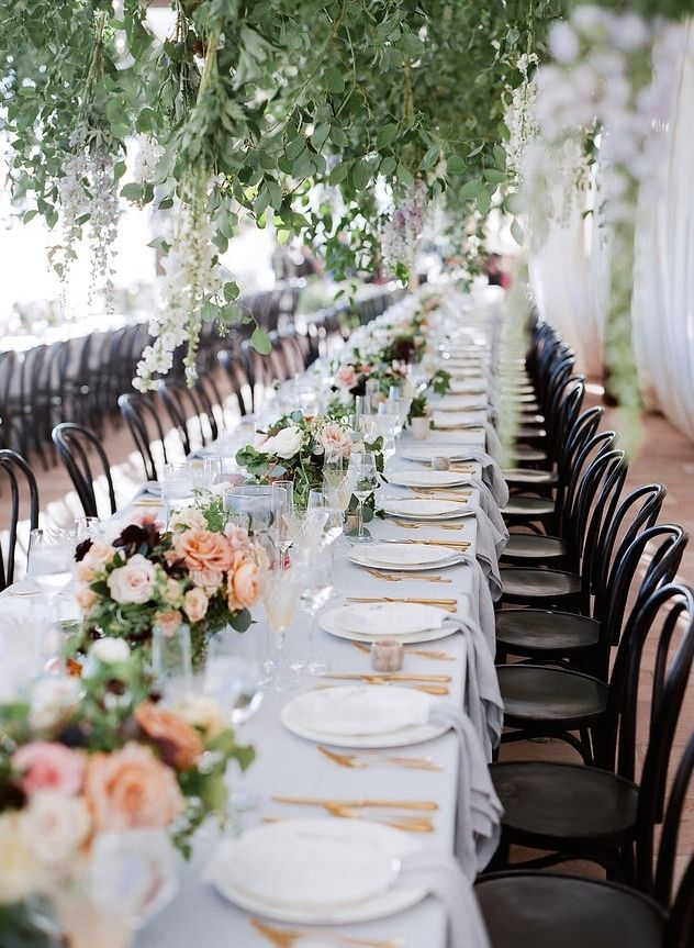 Traditional Wedding Reception Table With Pink And White Flowers And Black Chairs Wedding Reception Chairs Wedding Reception Tables Wedding Table Settings