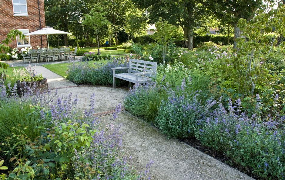 Accessible Family Garden Design In West Sussex With Breed On Gravel Path And Bench In Border Family Garden Garden Design Gravel Garden