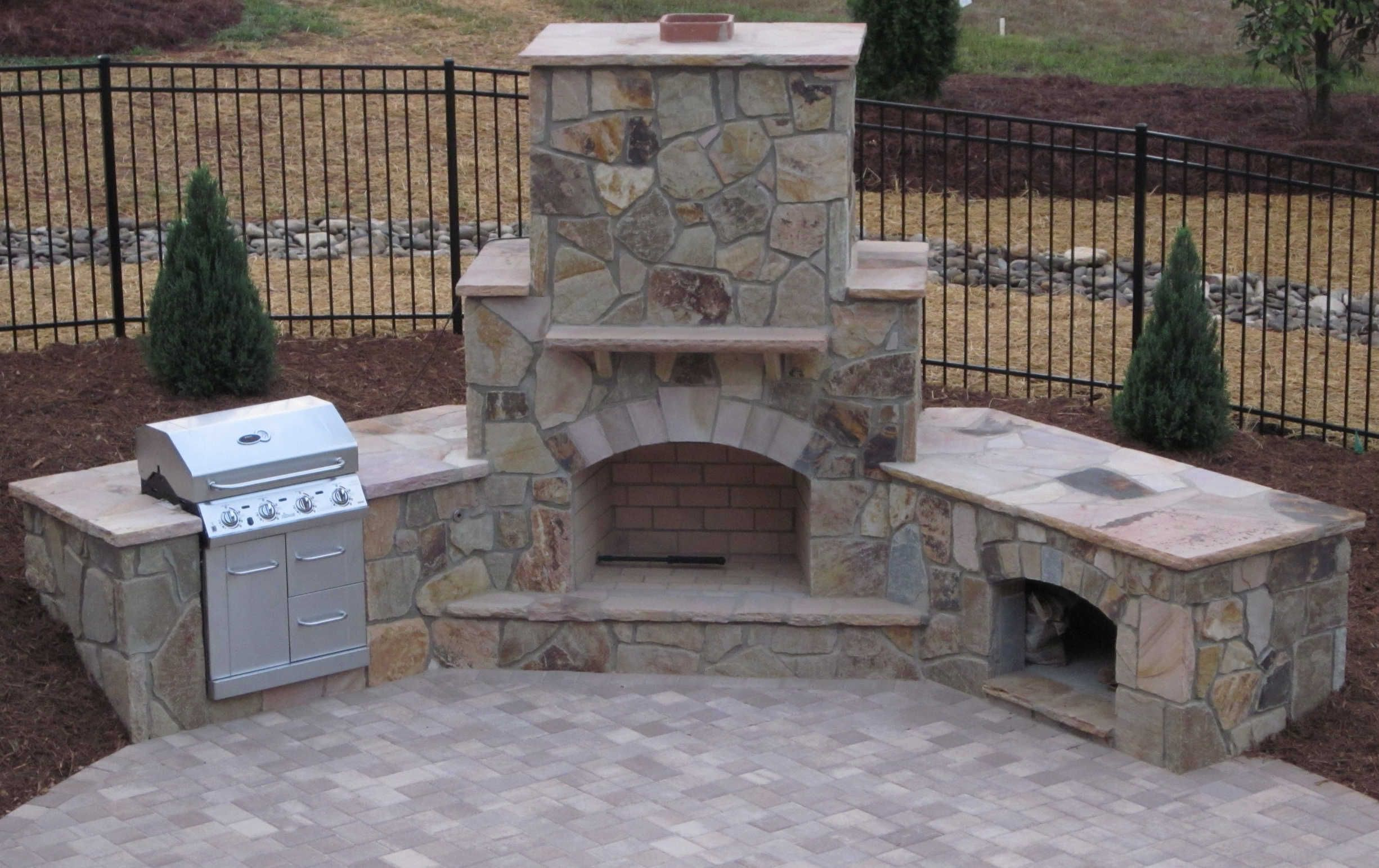Stone patio with fireplace stone outdoor fireplace grill for Outdoor patio fireplace ideas