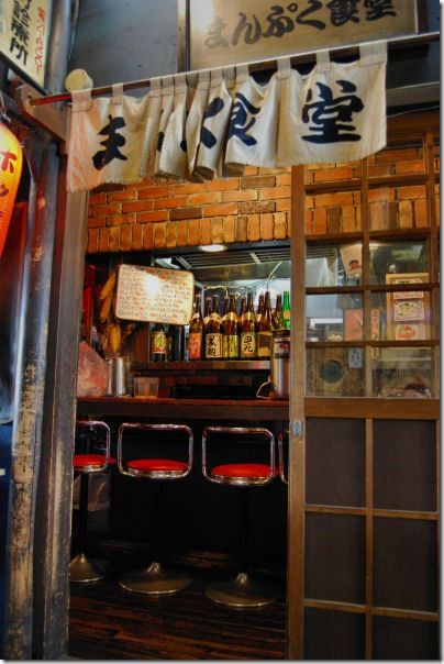 """Yūrakuchō (有楽町) is a neighborhood of Chiyoda, Tokyo, Japan that borders the glamorous and upscale neighborhood of Ginza. Yūrakuchō is an older part of city, with its many izakaya (Japanese-style bars, denoted by their red lanterns known as akachochin) and outdoor yakitori restaurants (""""yakitoriya""""), many of which are located under the train tracks serving Tokyo's JR Yamanote Line. Yūrakuchō is a favorite drinking spot for businessmen on their way home from work."""