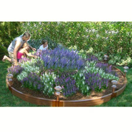 Circular raised garden bed with solar lights for Circular raised garden bed ideas