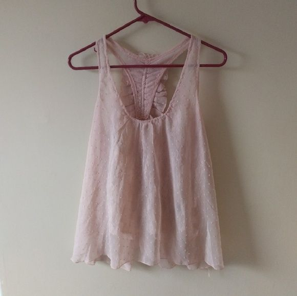 Light Pink Tank Top Preloved Rue 21 top. Has a sheer lace underlining layer and a sheer polka dot top layer. It is a razor back top with ruffles on the back as shown in third and forth pictures. Since it is see through a tank top or bandeau will have to be worn. Rue 21 Tops Tank Tops