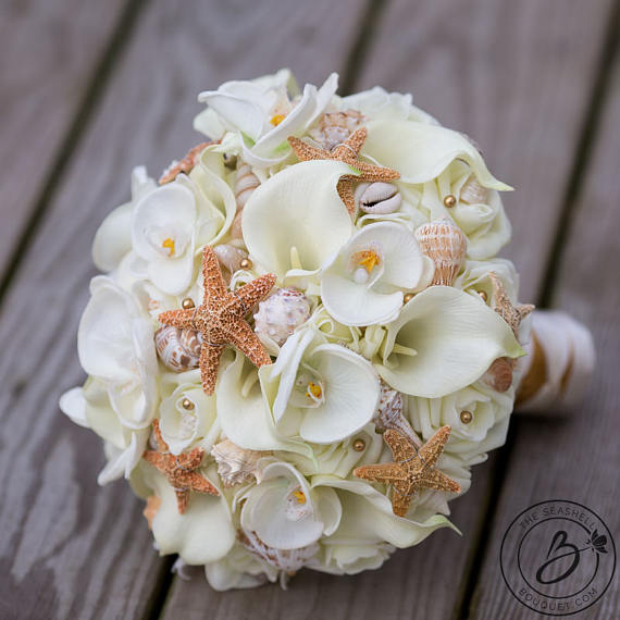 A Fun And Elegant Seashell And Starfish Bouquet Mix Of Our Signature Cream Soft Touch Roses Real Calla Lily Bouquet Wedding Beach Bouquet Beach Theme Wedding