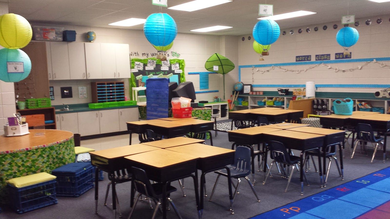 Hot Air Balloon table groups with continent signs! Traveling themed classroom