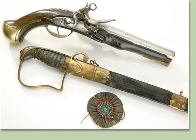 Naval flintlock pistol, captured from French warship Intrépide British midshipmans sword, Midshipman John Wells French cockade  The pivotal naval battle of the Napoleonic Wars was the Battle of Trafalgar where the British under Admiral Horatio Nelson decisively defeated a combined French and Spanish fleet in 1805. There are a number of artifacts in the collection related to Nelson, Trafalgar and naval warfare at the time including the pistol, cockade and sword seen here which were actually
