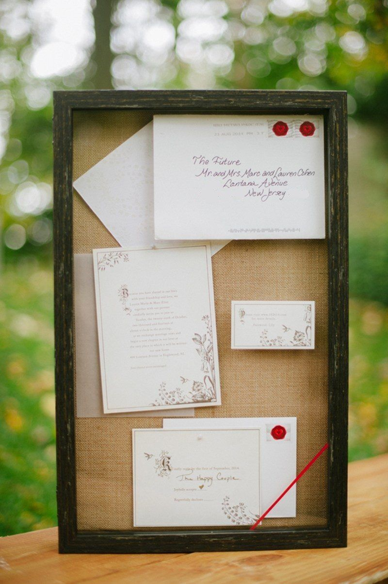 Wedding post box decorations  Show off your invitation suite as decor on a cork board at your