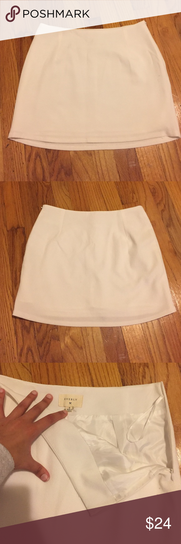 Everly Mini Skirt True white Everly mini skirt. Size Small. Waist measures about 14 inches and it is about 13.5 inches long. Loved this skirt and even took the tags off, but the right event never presented itself for me to wear it. Very classy material and has a 100% polyester lining. Like new. Everly Skirts Mini