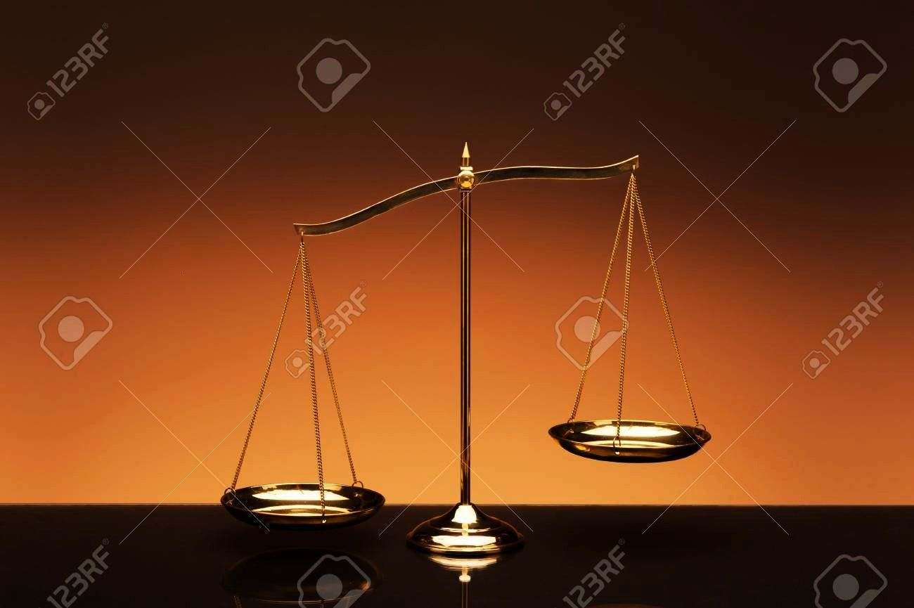 brass balance or imbalance scale on orange color background Weight balance Symbol of law justice libra decision crime financial Golden brass balance or imbalance scale on...