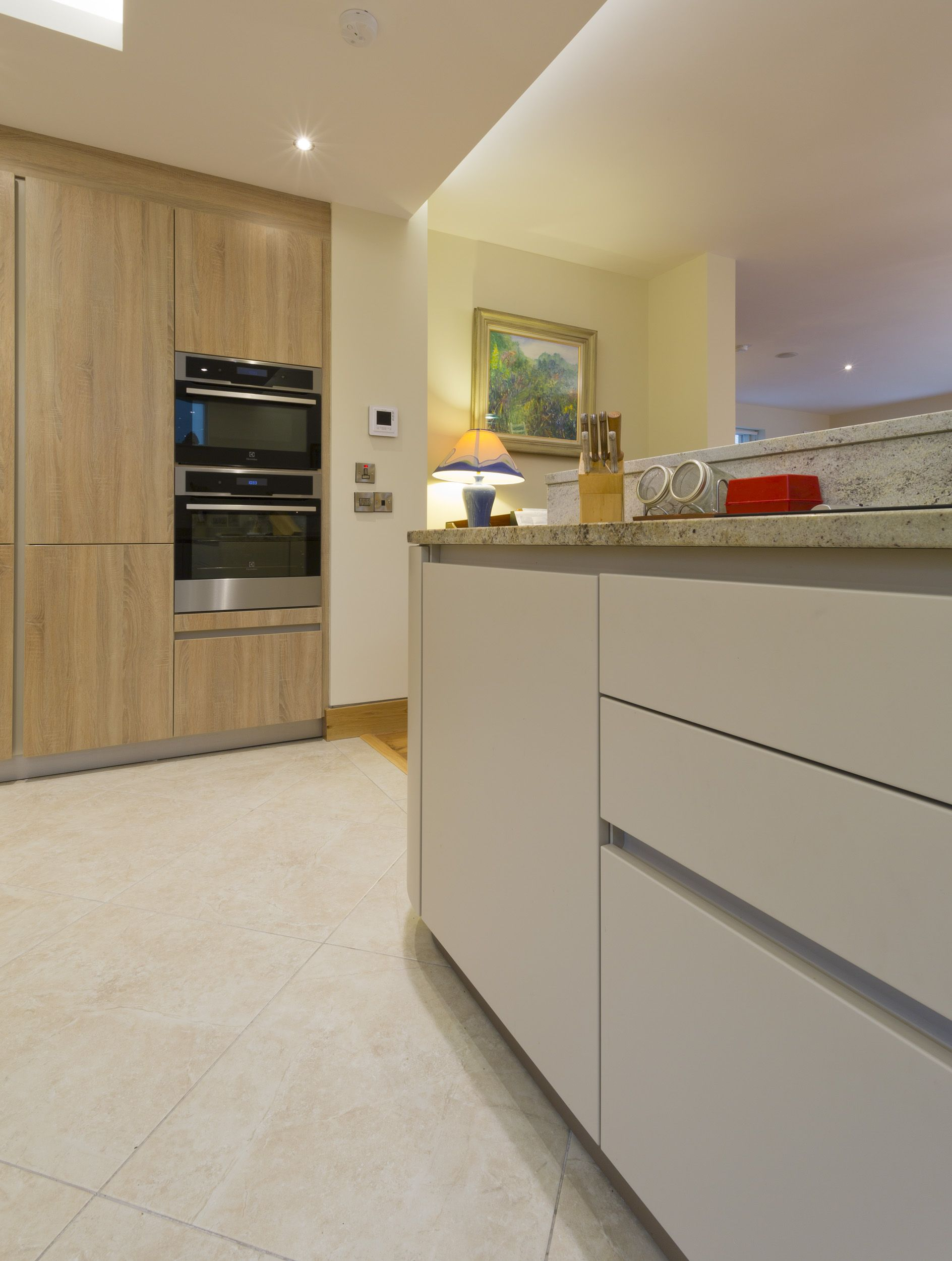Plinth Lighting For Kitchens A Schuller Kitchen With Champagne Matt Base Units And Samo Oak