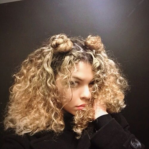 Say Goodbye To The Half Up Half Down Bun Double Buns Have Officially Taken Over As The Trendiest Co Curly Hair Styles Hair Styles Curly Hair Styles Naturally