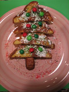 Christmas Tree French Toast.  Powdered Sugar, Green Sprinkles, M, Sausage for the Trunk.