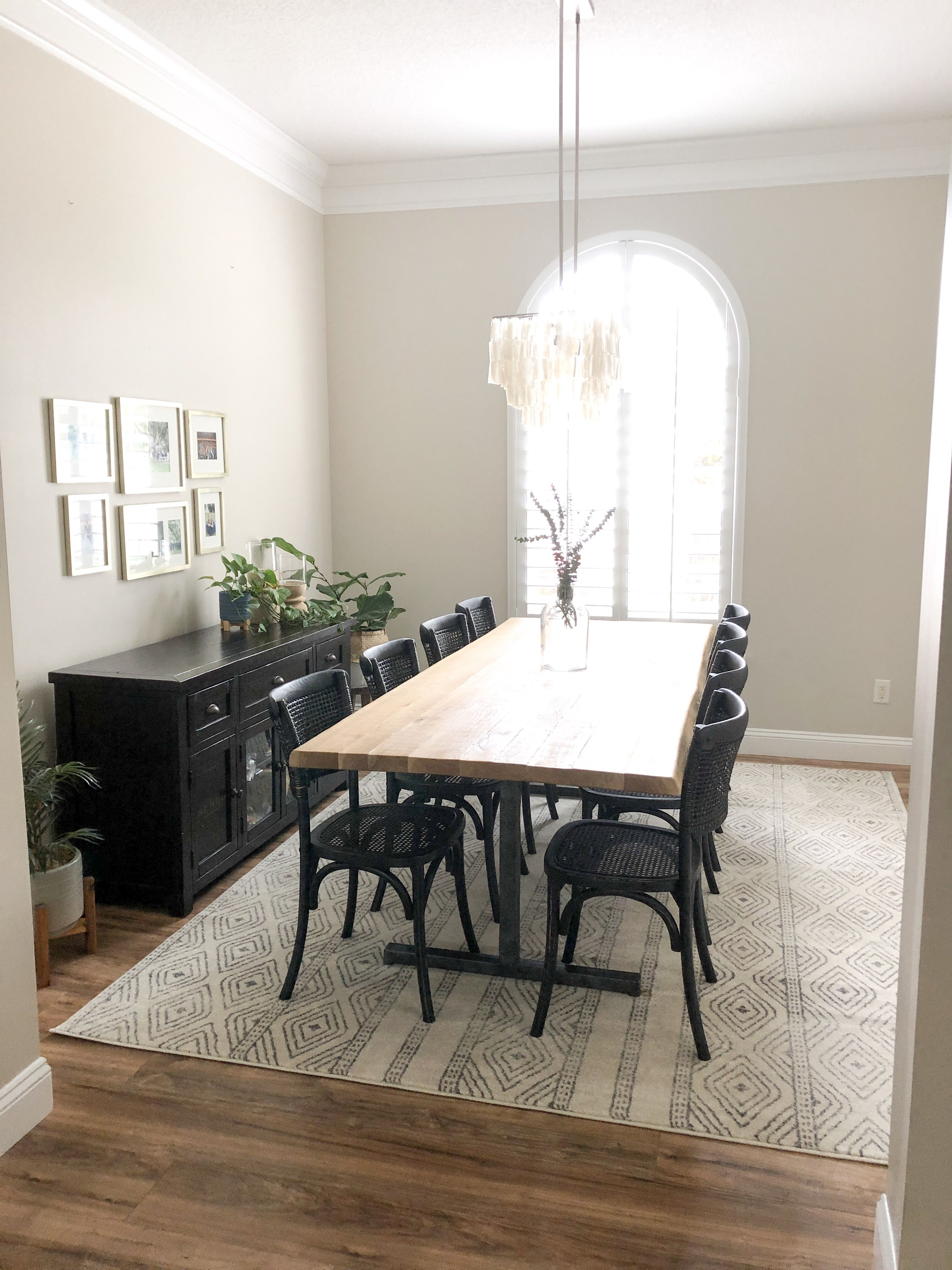 Modern Bohemian Dining Room. Black Dining Chairs. Live edge ...