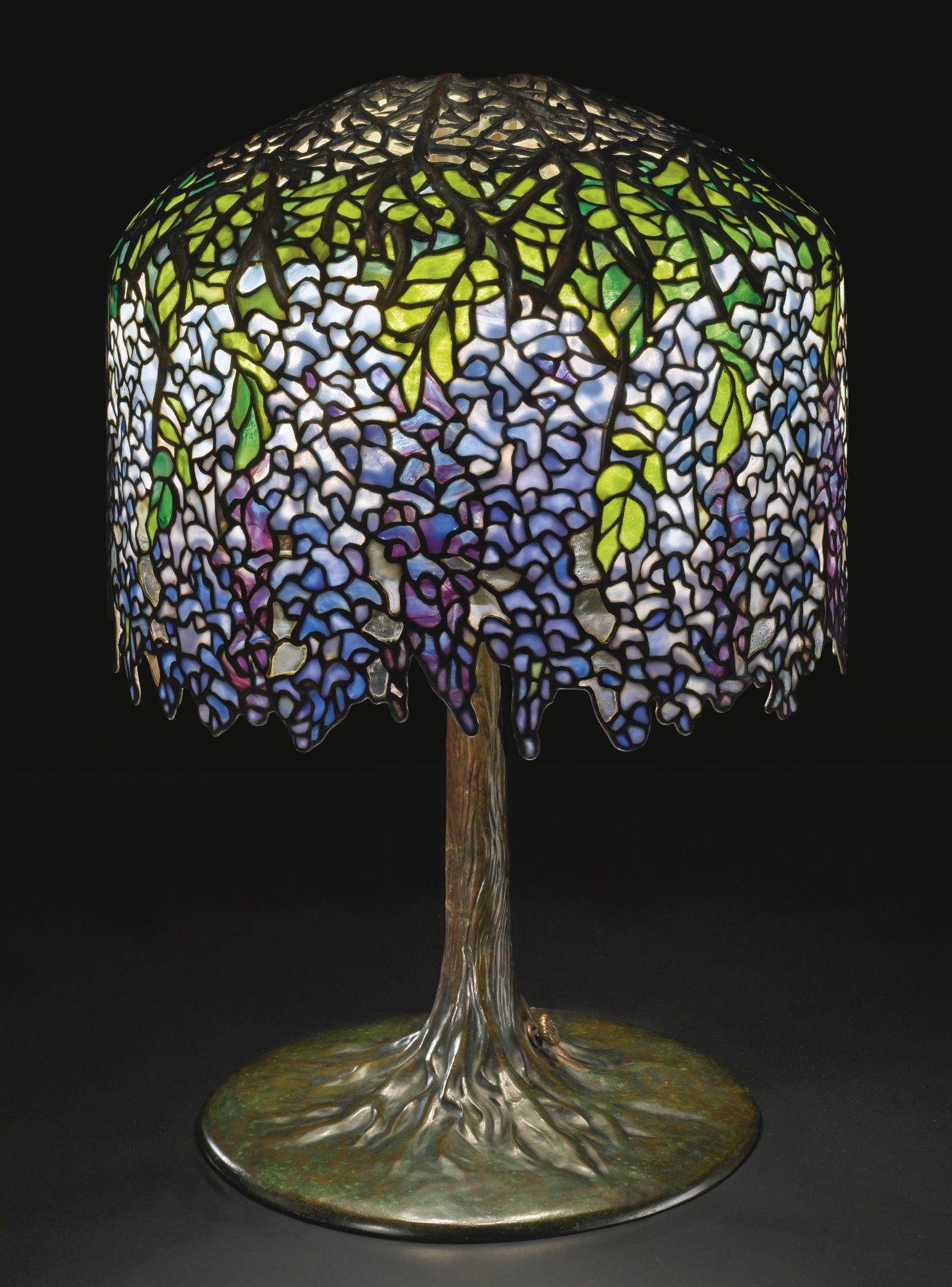 Tiffany studios new york wisteria leaded glass and patinated tiffany studios new york wisteria leaded glass and patinated bronze table lamp mozeypictures Image collections