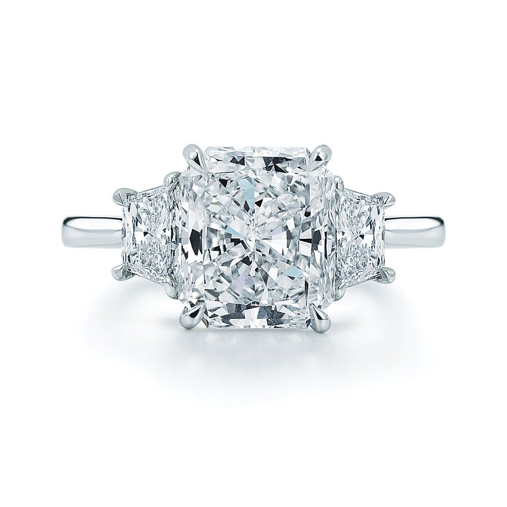 Kwiat: Radiant Cut Diamond And Platinum Ring With Two Trapezoids