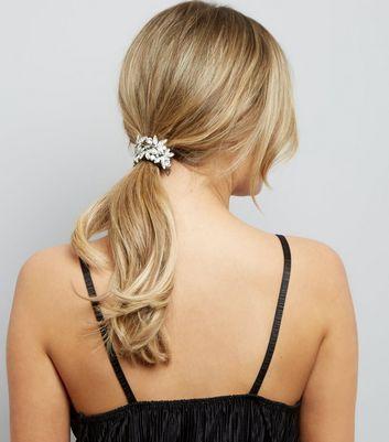 - Silver finish- Diamanté flower design- Elasticated fastening