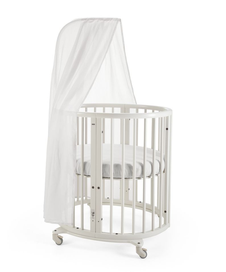 Four beds in one.™ Stokke® Sleepi Mini is the perfect first bed for your baby. Its distinctive oval shape provides your baby with a sense of security by creating a cozy nest-like environment.