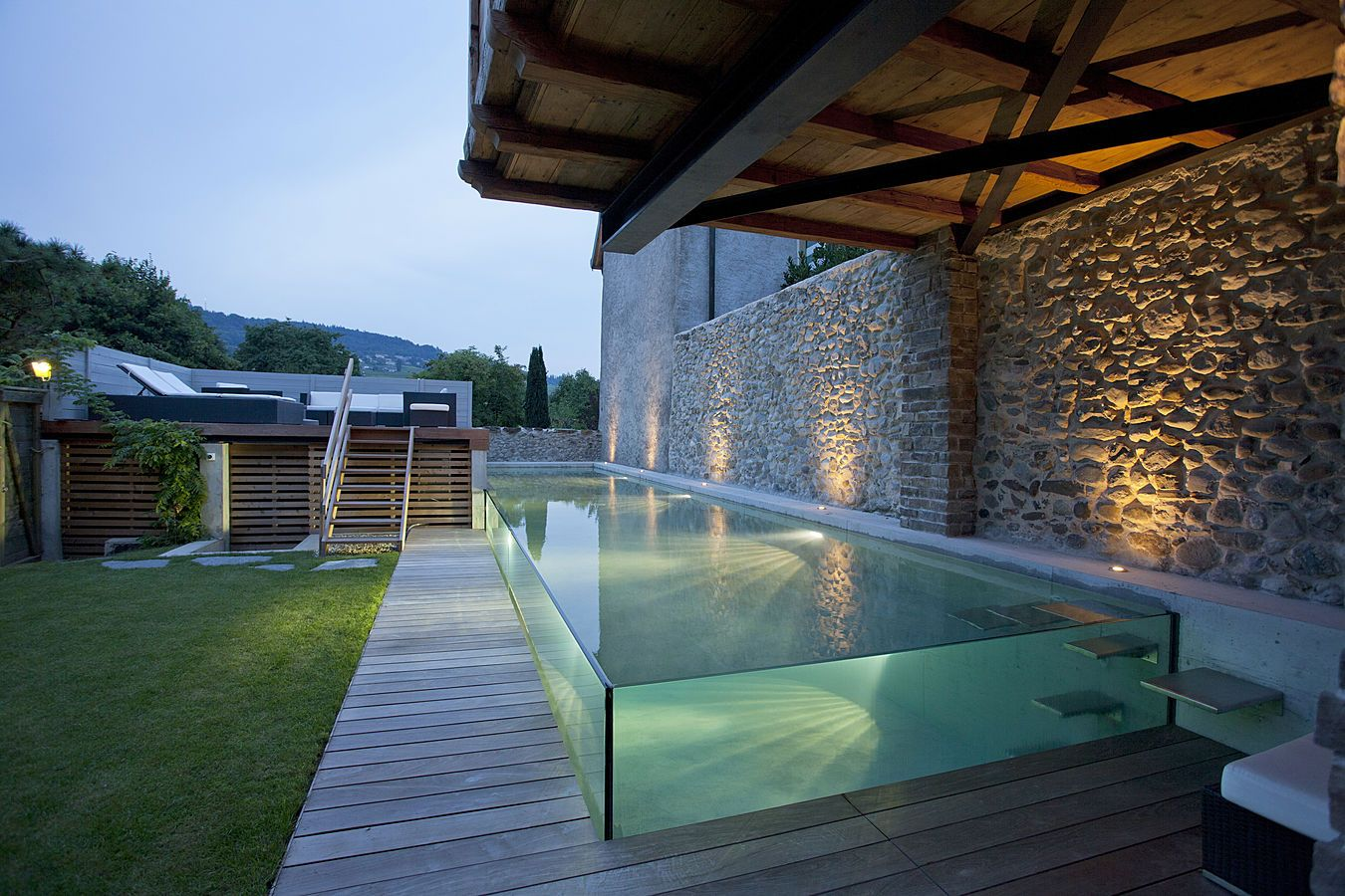 The Excelsior swimming pool with glass walls by Carré Bleu