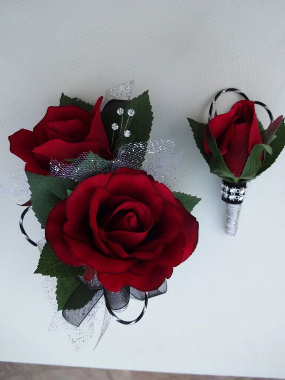Red rose corsage with matching boutonniere