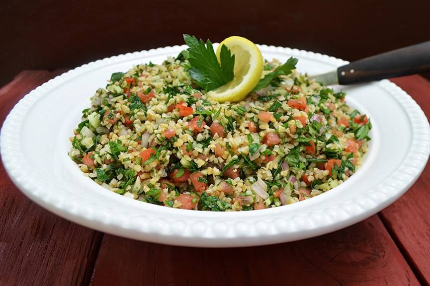 My Riff on a Classic Lebanese Salad By Andrew Zimmern  Tabbouleh is chock full of fresh, in-season summer ingredients such as tomatoes, cucumbers and fragrant herbs. It's not only healthy and packed with that bright citrusy flavor you crave this time of year, tabbouleh is a cinch to make. Be sure to let the composed salad rest for a couple hours before serving, allowing all of the flavors to meld together.