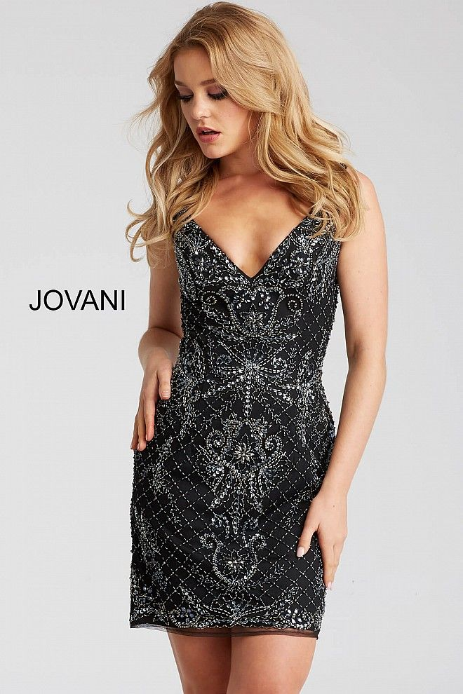 e9063ca3231 Form fitting embellished short black dress features sleeveless bodice with  v neckline and open back