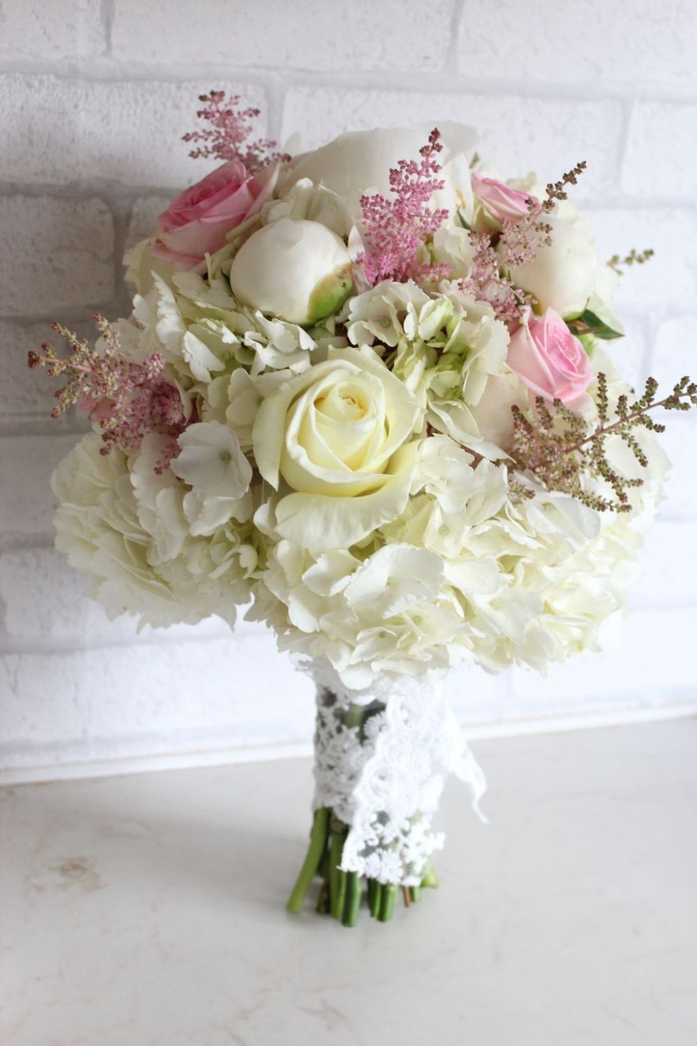 White and light pink wedding bouquet. Hydrangea, peonies, roses ...