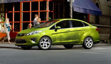 The 2013 Fiesta Titanium Sedan Shown In Lime Squeeze Metallic