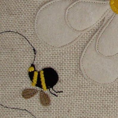 Close up detail of one of my busy bees. These are individually cut out & sewing machined on. Takes me a little while, but I do love them.