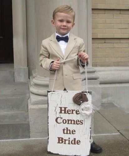 super cute! need to make this sign! for chris to walk down the isle for me. :)