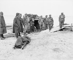 William Joseph Brunell, British and Italian troops guarding Austro-Hungarian prisoners in a dug out by the River Piave at Salettuol, November 1918