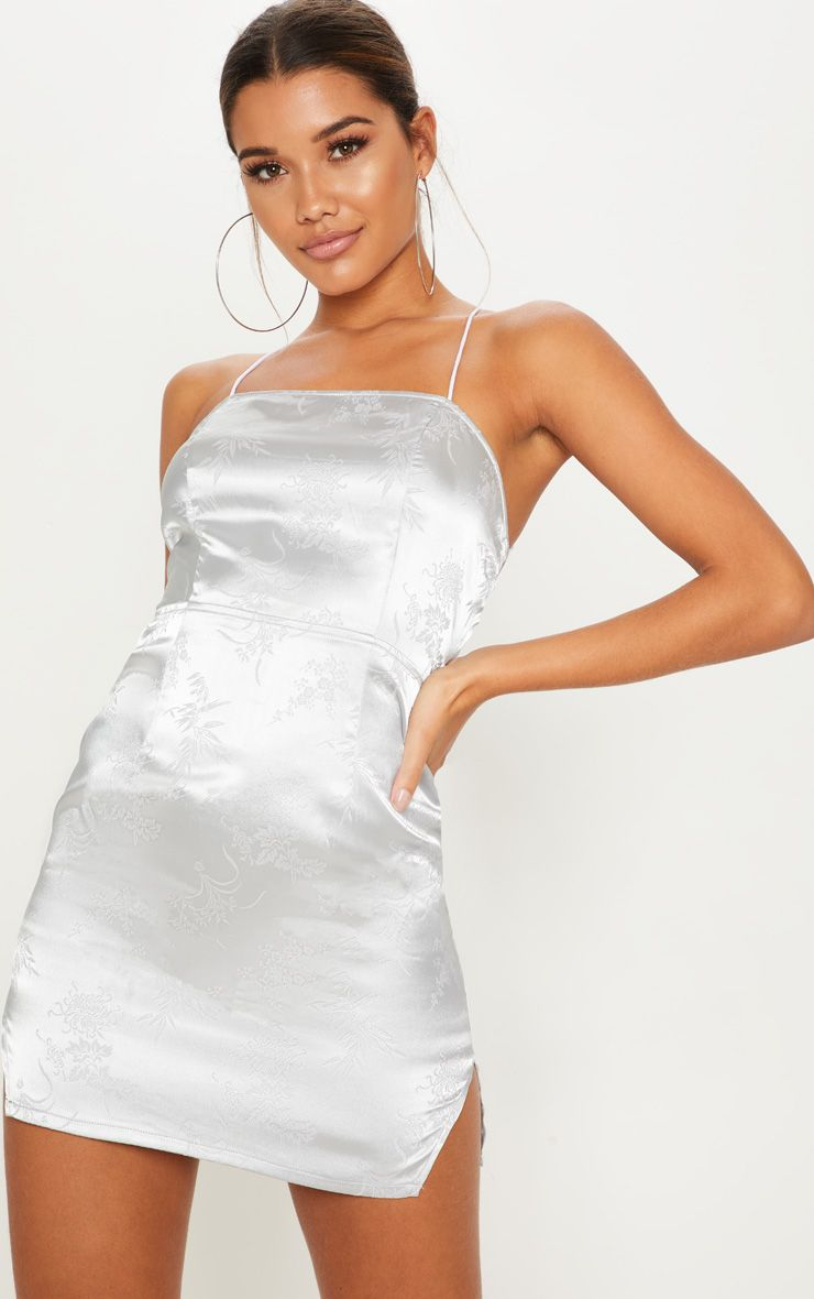 e4c25eb95831 Silver Satin Oriental Lace Up Back Bodycon DressGet party ready in this  slinky bodycon dress. Fea.