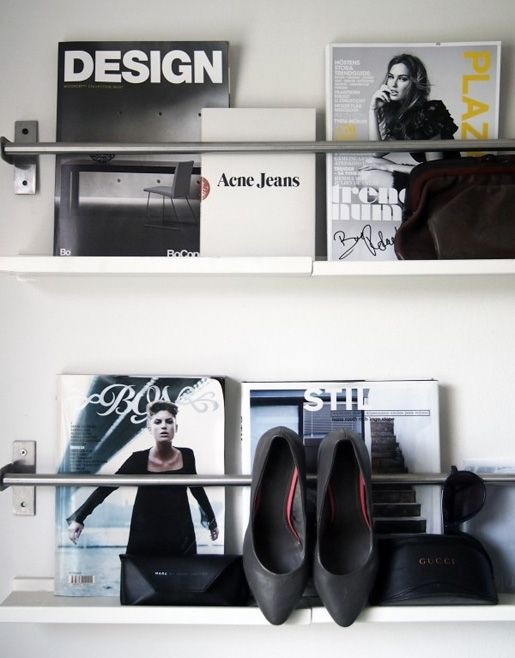 store magazines, books, shoes with shelves and a hanging rod.