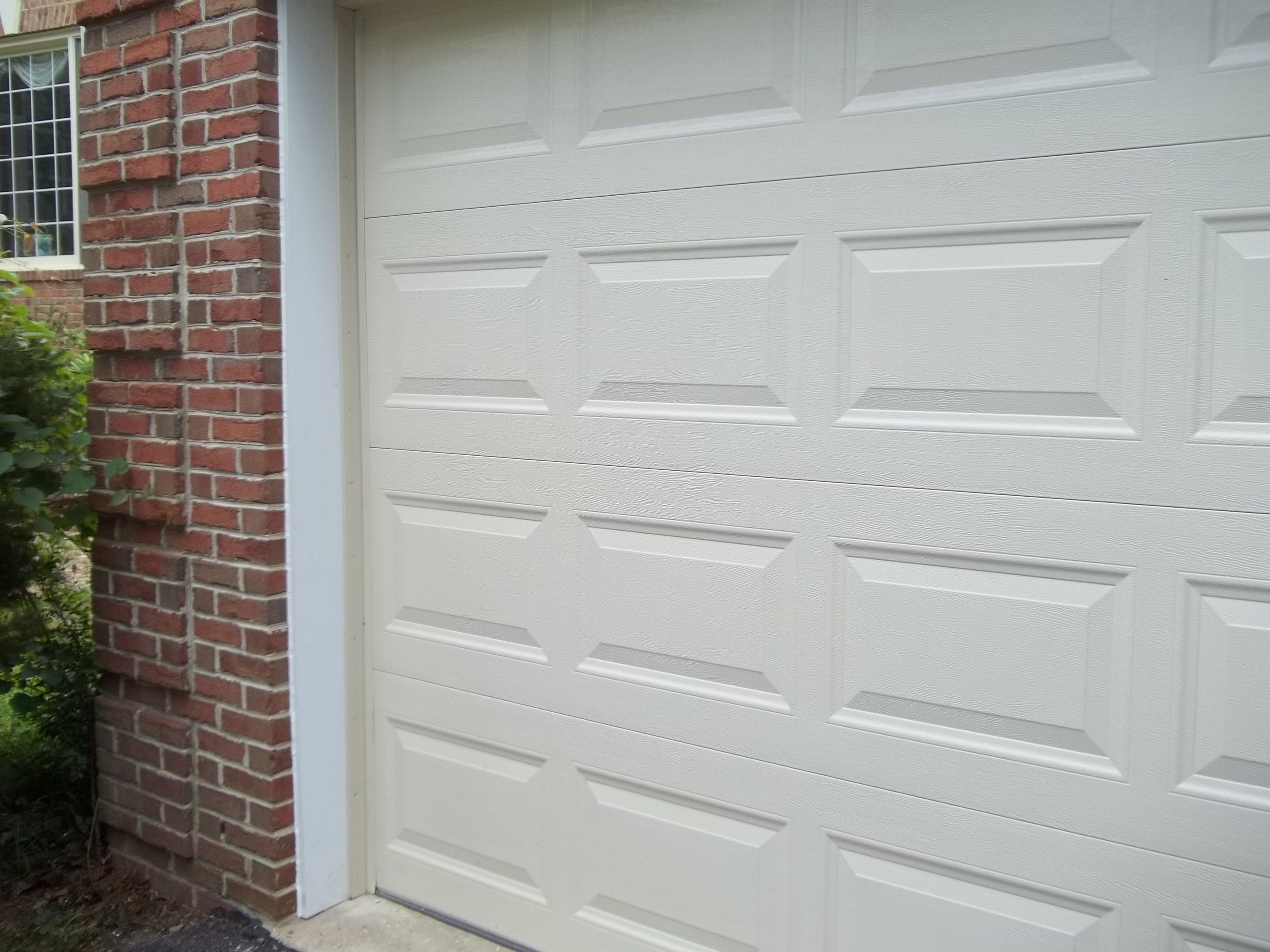 After photograph of completed PVC trim installation of garage door ...