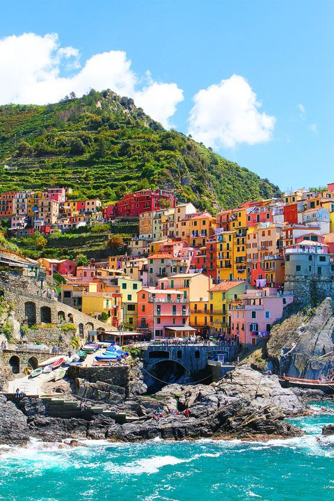 Manarola, Italy - It's in the province of La Spezia, Liguria, northern Italy. A unique place called 'Cinque Terre ' (which means Five Towns literally and this is one of the town, they are right next to each other). If you go to Tuscany, you can make a day trip there.