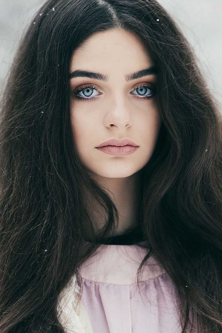 Black haired girl with blue eyes