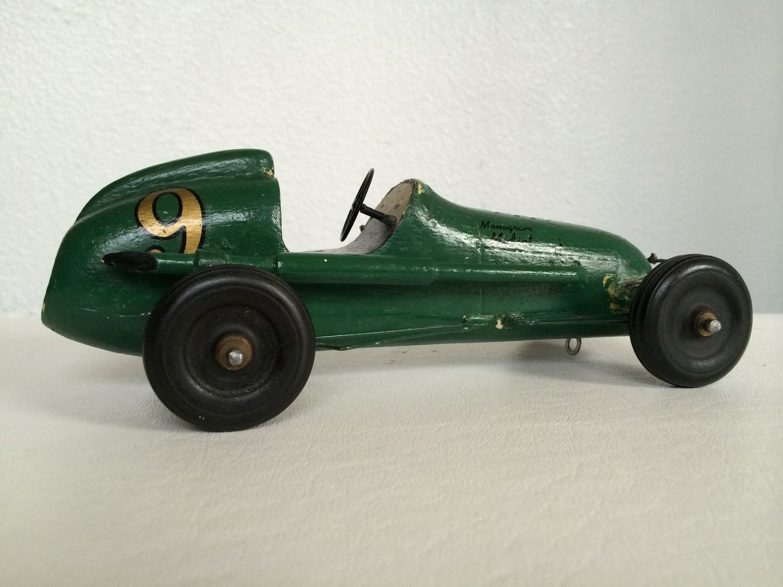 A carved wooden 1950\'s style race car - not strictly a tether car ...